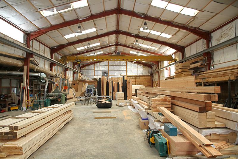 Béton, bois, acier : quelle structure pour la construction de mon local industriel ?